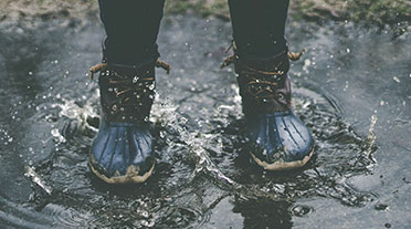 Boots in a puddle of water