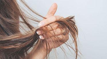 Lady holding hair