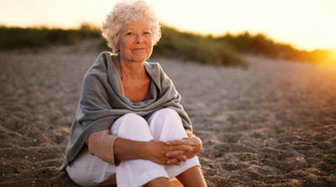 Lady with Alzheimer's Sat on Shingle